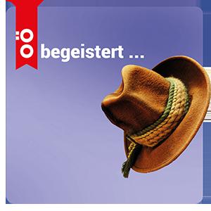 Das Bild zeigt einen Hut auf lila Hintergrund sowie den Schriftzug 'OÖ begeistert ...'