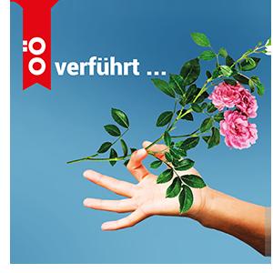 Das Bild zeigt eine Hand, die eine Rose hält, auf blauem Hintergrund, sowie den Schriftzug 'OÖ verführt ...'